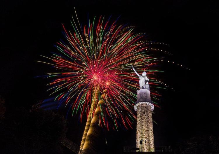 The Vulcan, a Birmingham nonprofit, and fireworks behind it.