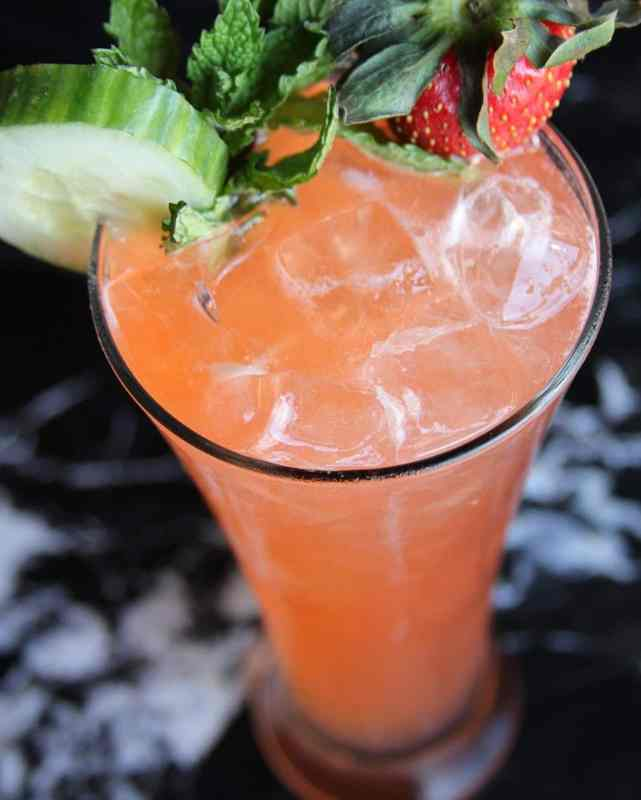 Cocktail with strawberry on top