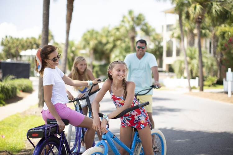 Family smile and use bikes at ResortQuest vacation destination
