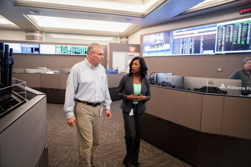 Shardra Scott, Alabama Power's System Operation Manager, walks through the Birmingham Control Center with a colleague