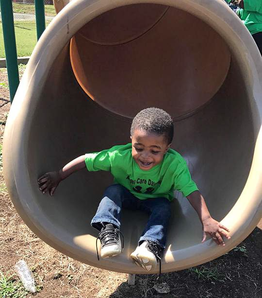 Child Laughs in a Slide