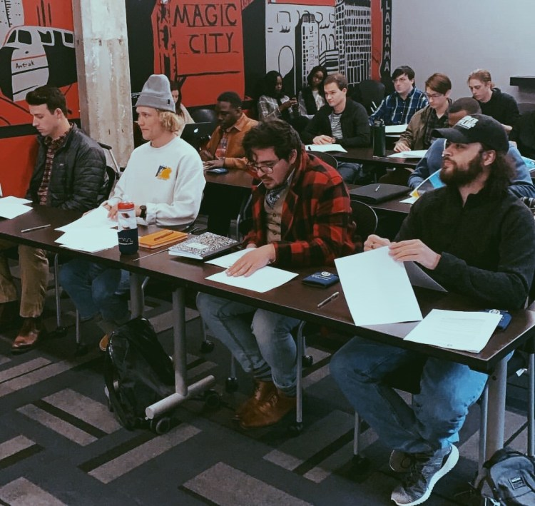 A large group of students gathered together for orientation at Innovate Birmingham.
