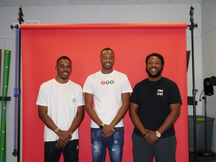 Three Men Stand and Smile at Vibestreet Studios