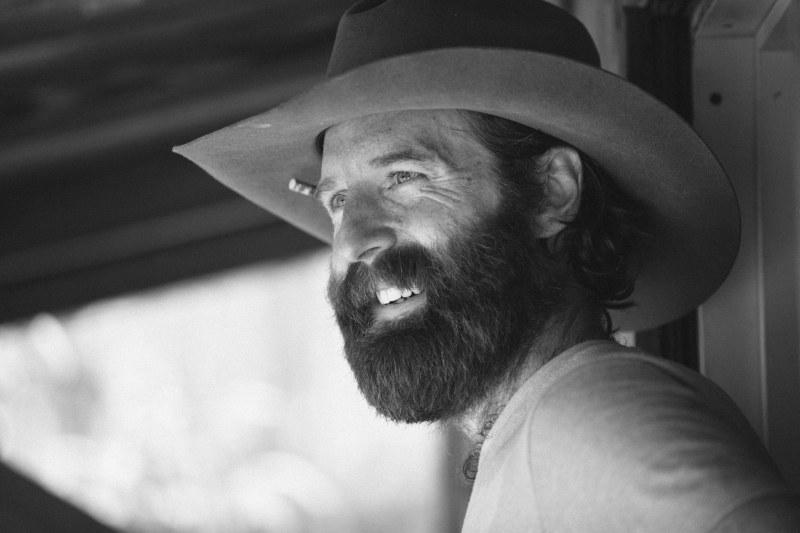 Man Smiles in a Cowboy Hat