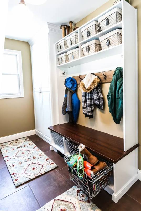A mudroom by Closets by Design gives everyone their own space