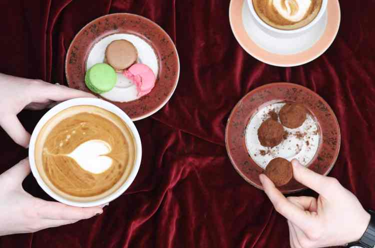 Coffee and macaroons on a table.