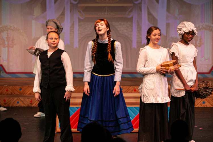 RMTC girls sing on stage