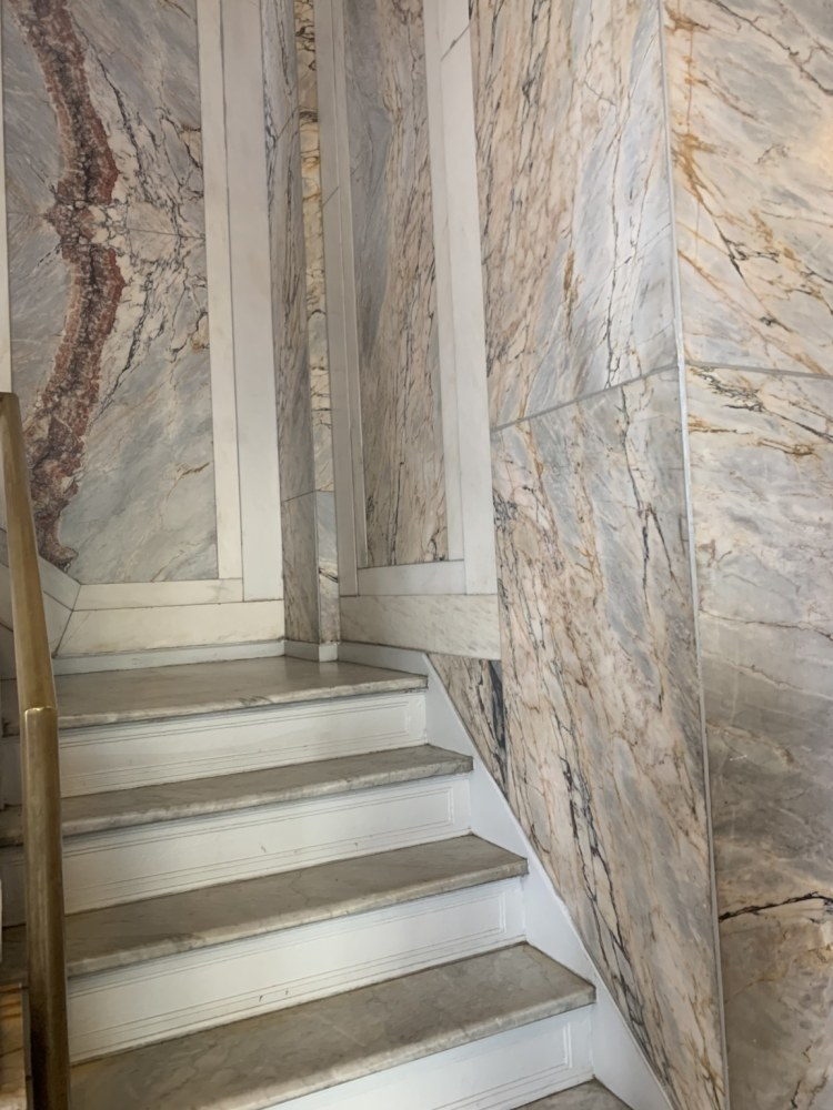 White marble with European influence on the inside of hotel.