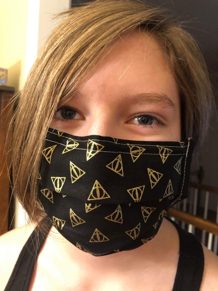 A student wearing a mask