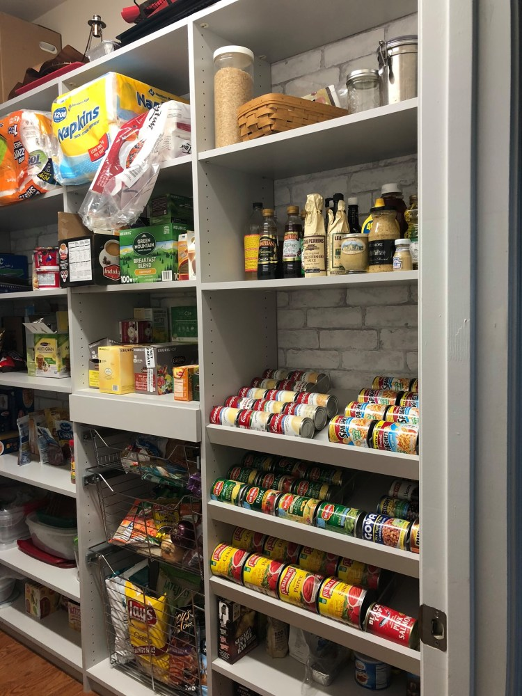 You could turn the bottom shelves of a pantry like this into a kid station