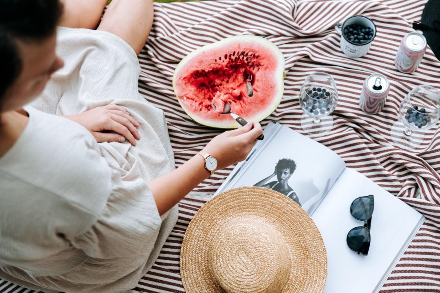 woman slicing watermelon fruit