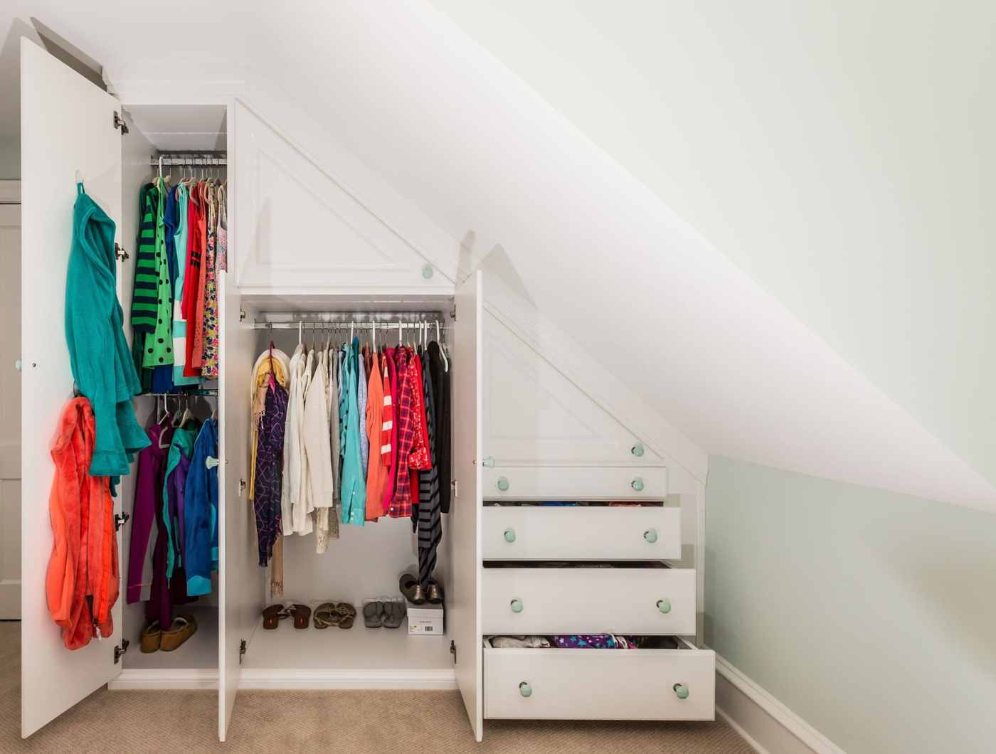 organize your child's room with a closet under the eaves or staircase