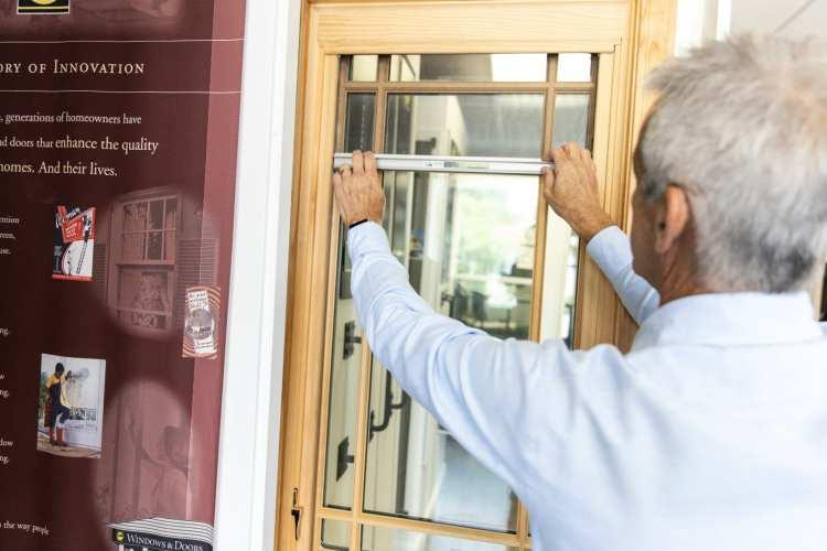 Jorge Echave in front of a Rollscreen window at Pella's Birmingham showroom