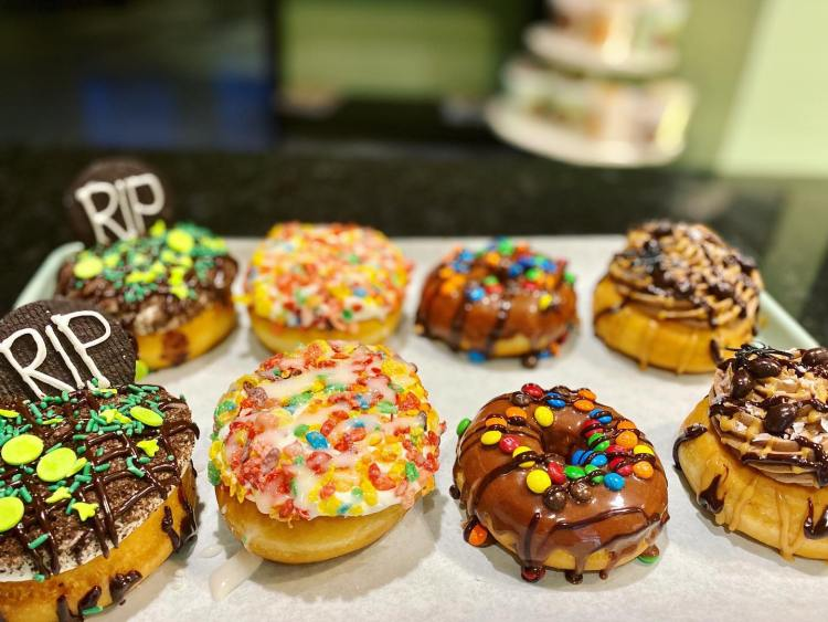 Variety of colorful donuts at Dreamcakes Cafe, dessert place in Hoover, AL