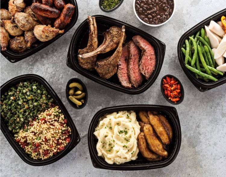 To-go plates of food from Texas de Brazil