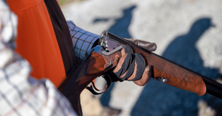 Man holding a shotgun at Orvis Sporting Grounds