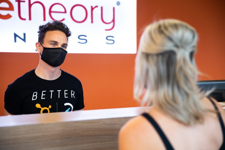 One of Orangetheory's coaches discusses goals with a member