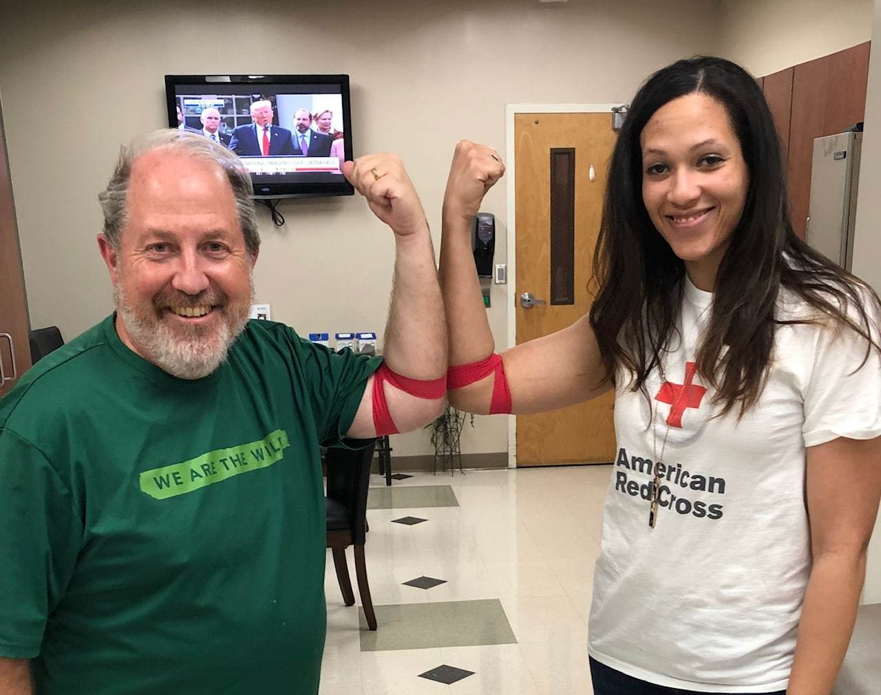 Pat Byington and Annette Rowland show off that they just finished donating blood