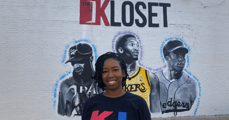 A. Nichel standing in front of Fairfield's new mural of Nipsey Hussle, Kobe Bryant and Chadwick Boseman