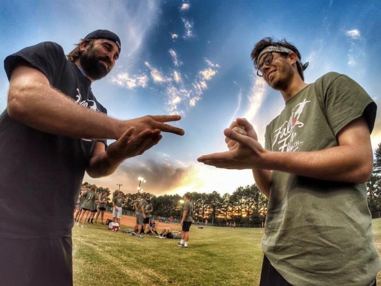 Two kickball captains playing rock, paper, scissors on kickball field