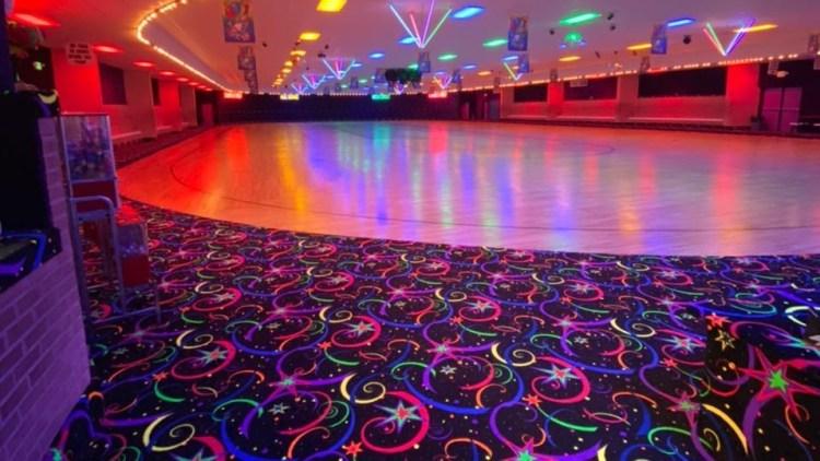 Roller Motion Skate Center neon lit Birmingham roller skating rink
