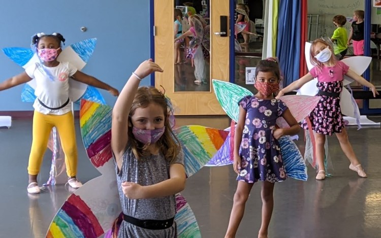 Masked dancers with paper fairy wings - Birmingham summer camps