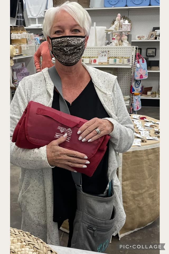 Local shopper picks out purse at Village Pharmacy