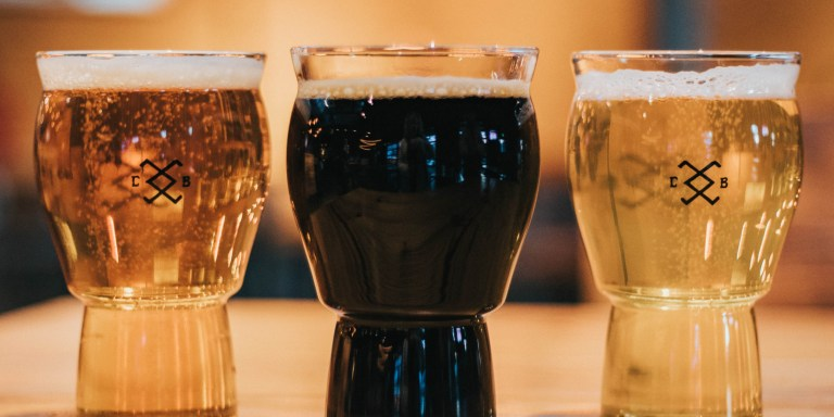 three pint glasses of beer