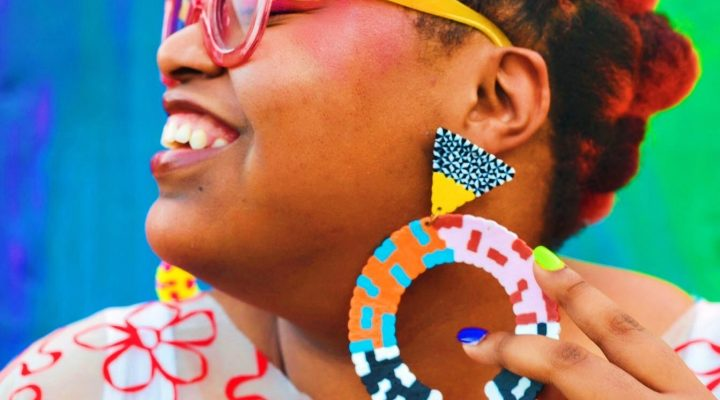 woman wearing big earrings
