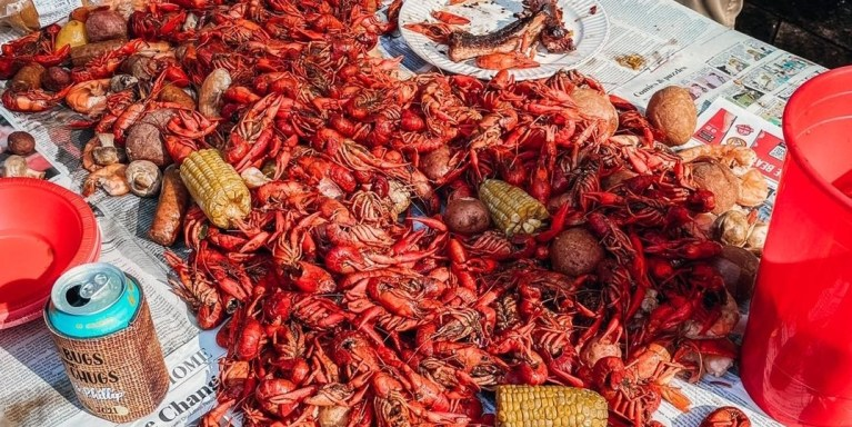 crawfish boil on a newspaper covered table