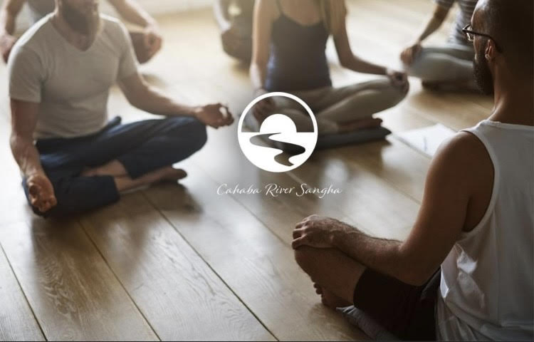 people sitting on the floor meditating