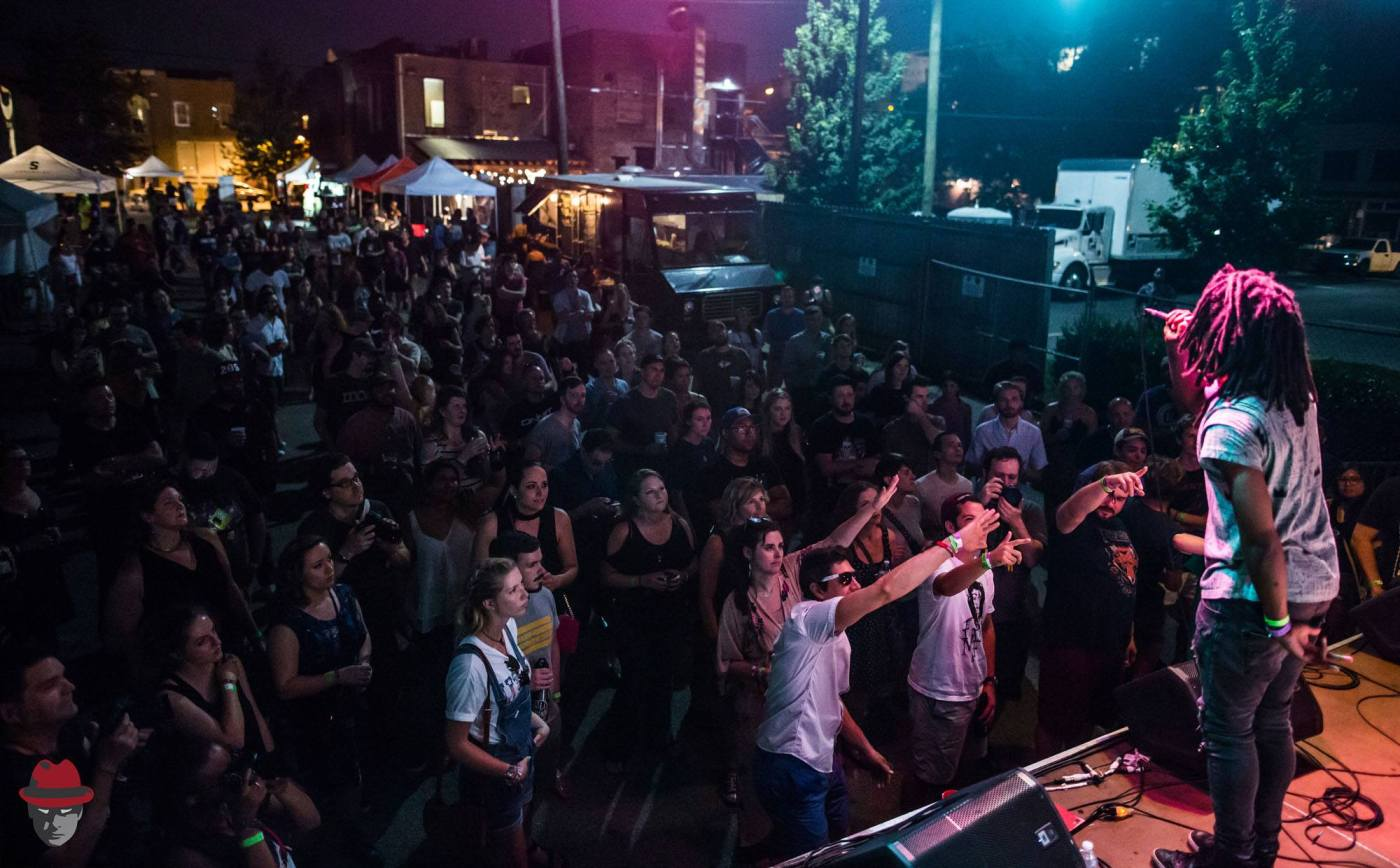 Dem Atlas performs to a crowd of entranced fans. Photo by Tyler Woods for Secret Stages