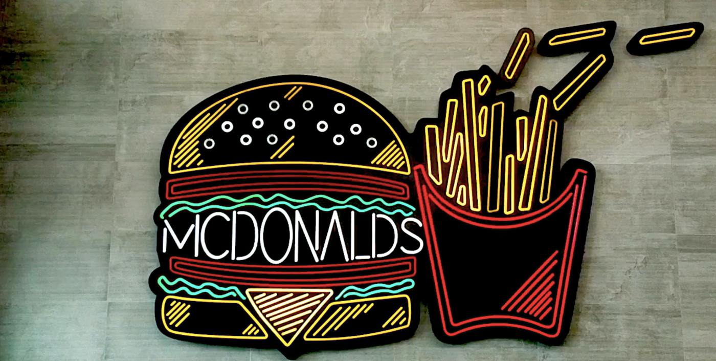 Neon McDonald's sign with burger and fries