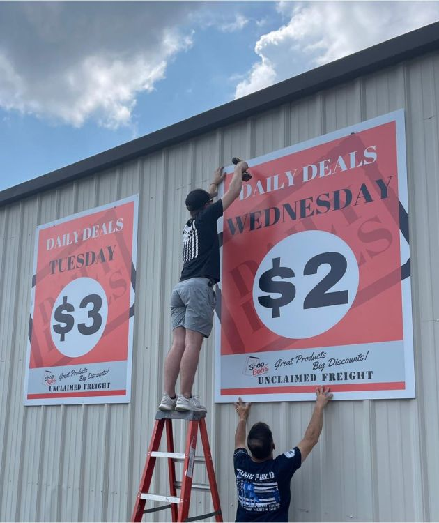 Signs going up at the new location of Bob's Unclaimed Freight.