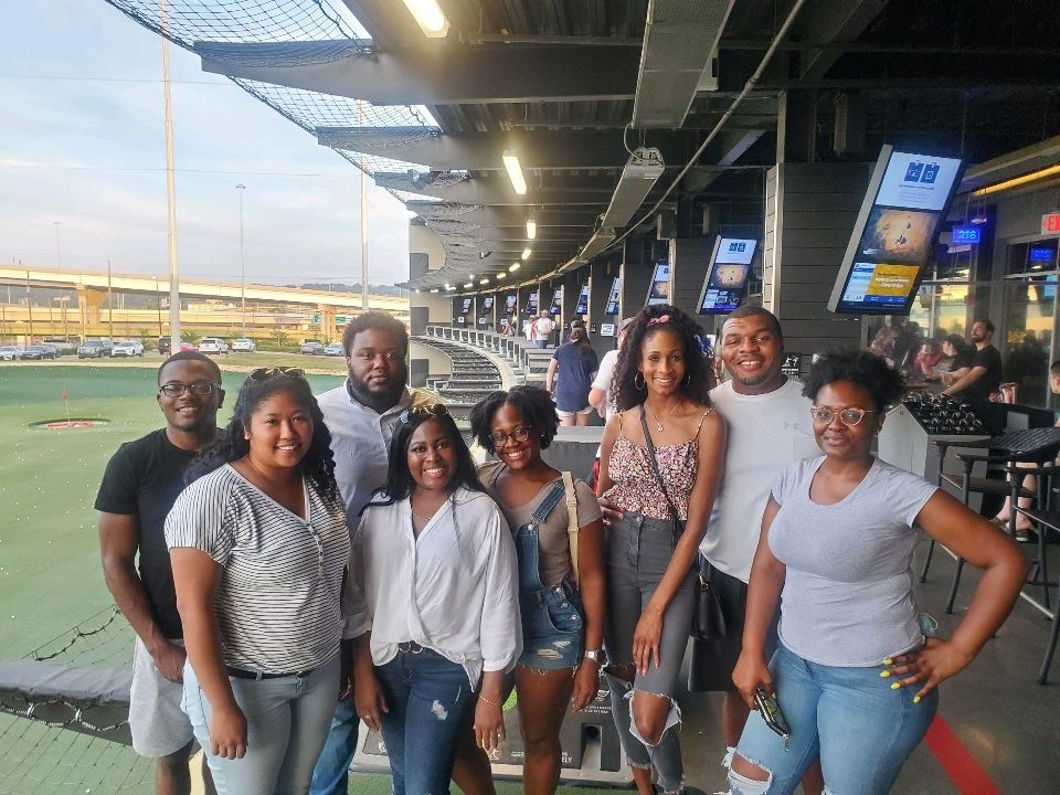 Members of young black professionals at an event
