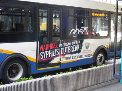 MAX bus in downtown Birmingham, AL with syphilis epidemic ad