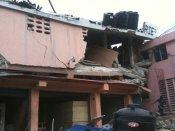 PHOTO: House split in half in Haiti. marvinady/twitpic