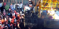 A ganpati being carried on top of a decoratedtruck