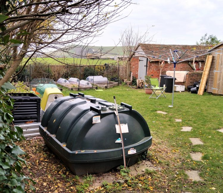 investing in renewable energy - removing fossil fuel oil tanks from Firle Village