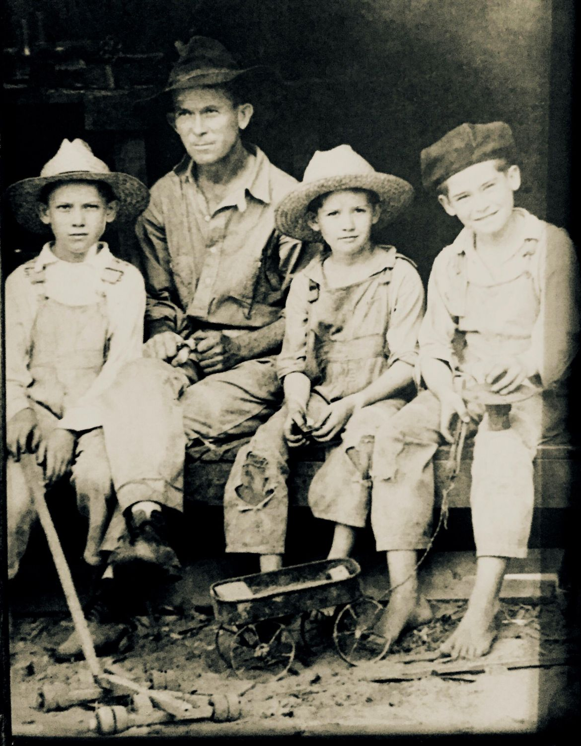 Visible mending on a kid's trousers from the Great Depression