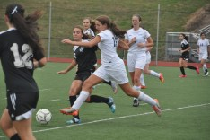 Senior co-captain Abby dribbles the ball