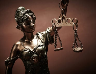 Lady of Justice Statue holding Scale