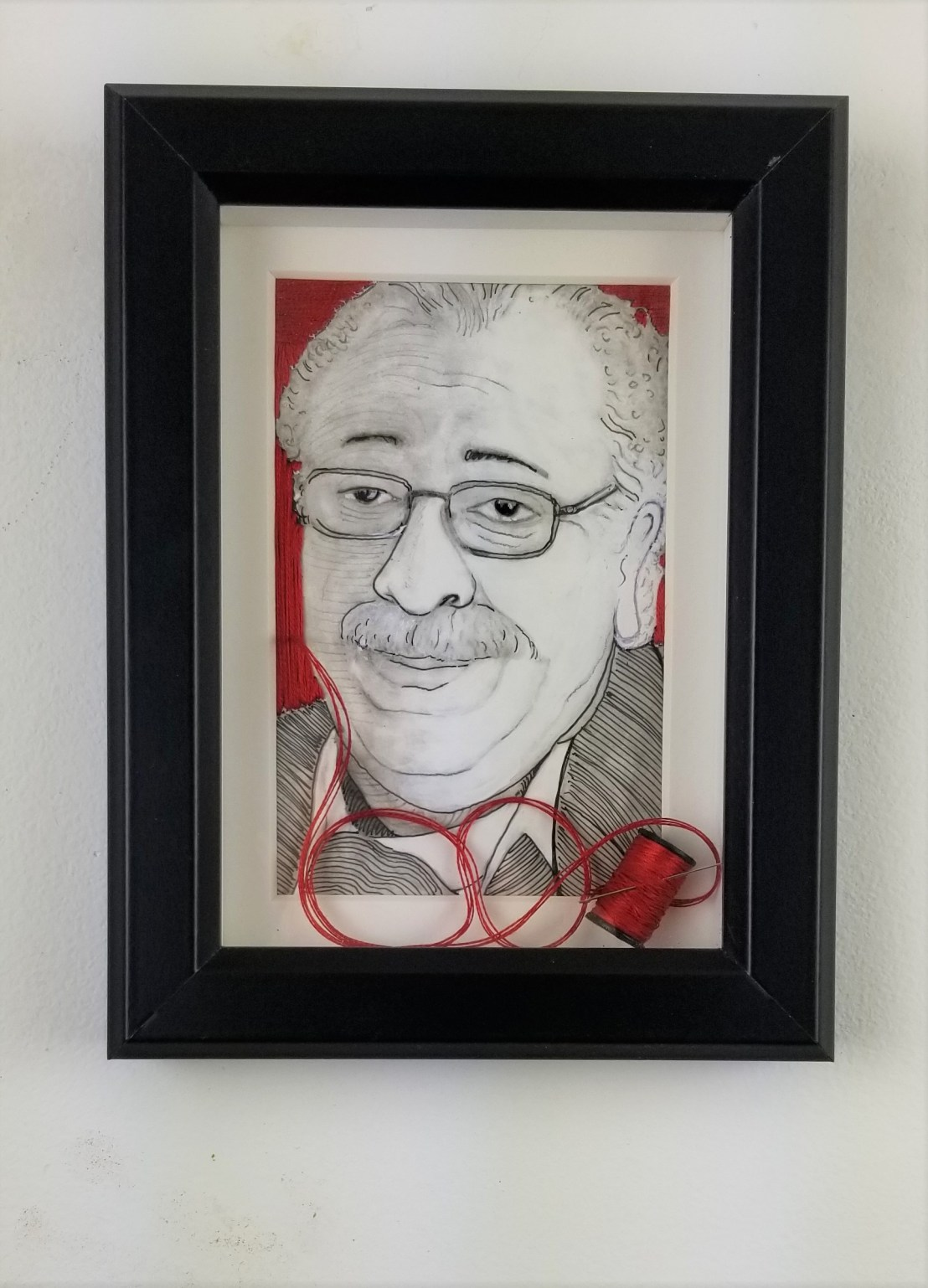 """""""Dr. Ray""""; ( Comes in a frame); 8in x 6in x 1in; Pencil, pen, and needle and thread on paper; Year 2018; Suggested donation is $350"""