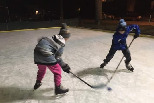 Kids battle for the puck at a pick-up hockey game at Lakeside Park.   Photo: Lakeside Community Rink via Facebook