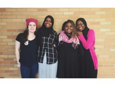 Emma Chaffee, Balkisa Abdikadir, Eliza Abedi and Hawa Adam pose for a photo on Jan. 25. Students wore black and pink to show support for women's rights.   Photo: OREAD