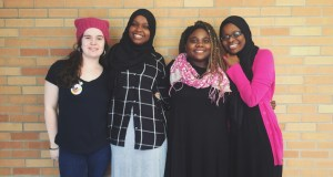 Emma Chaffee, Balkisa Abdikadir, Eliza Abedi and Hawa Adam pose for a photo on Jan. 25. Students wore black and pink to show support for women's rights. | Photo: OREAD