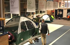 Students pitched tents in the lobby and hallways after winter weather moved the annual Spectrum Sleep Out event indoors.   Photo: Alexandre Silberman/Register