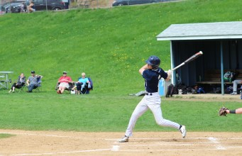 Junior Sky Rahill takes a swing in a game this season at Buck Hard Field. Rahill serves as a captain for the Seahorses.   Photo: OREAD