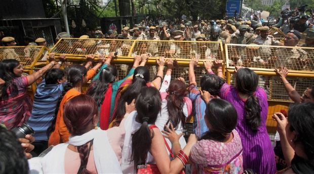 Protestors attempt to break through a barricade outside Delhi Police headquarters during a protest against the rape of a 5-year-old girl in New Delhi, India, Saturday, April 20, 2013. Officials say the child is in serious condition after being raped and tortured by a man who held her in a locked room in India's capital for two days. Police say the girl went missing Monday and was found Wednesday by neighbors who heard her crying in a room in the same New Delhi building where she lives with her parents. (AP Photo)