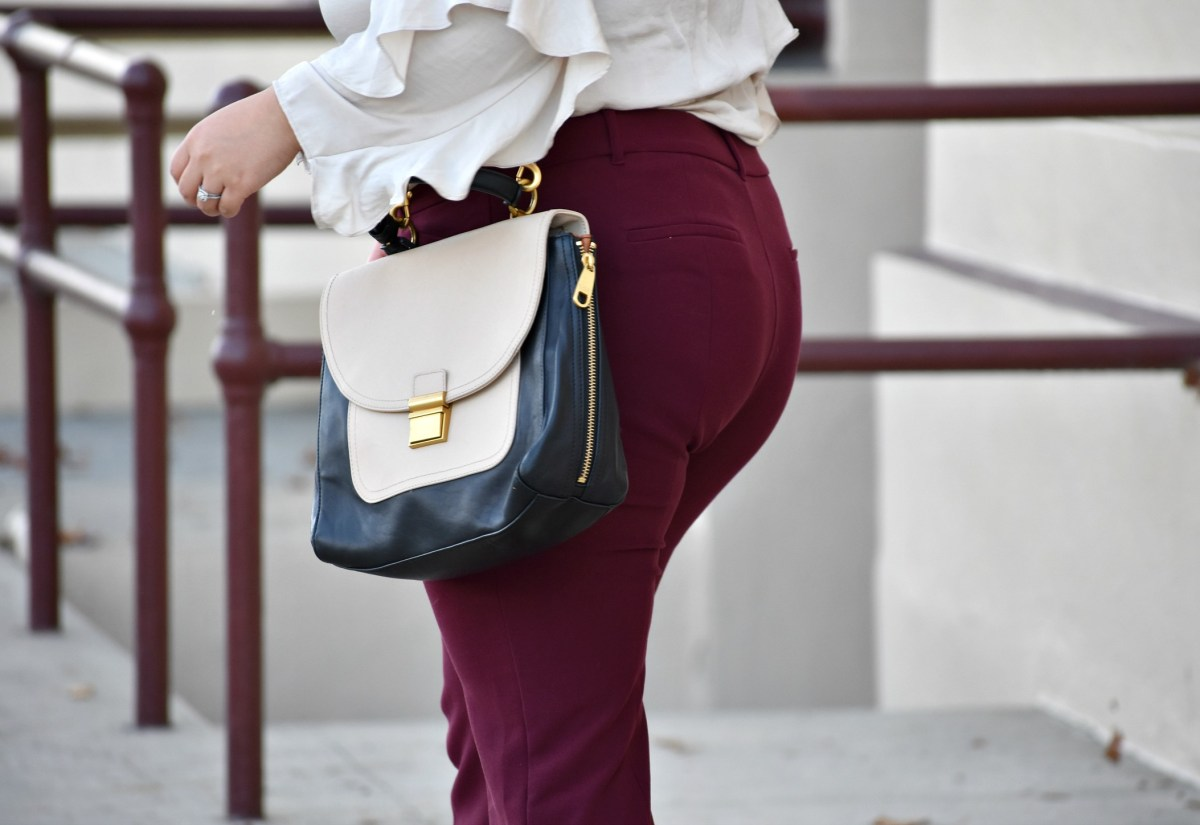 Plus size professional in burgundy trousers; OOTD